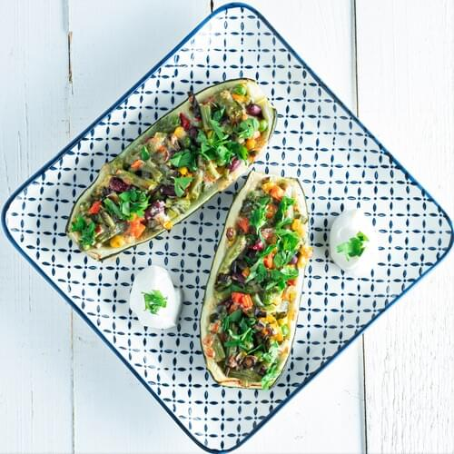 Кабачки, фаршировані овочами